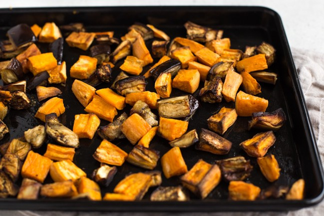 Roasted sweet potato and aubergine (eggplant) on a baking sheet