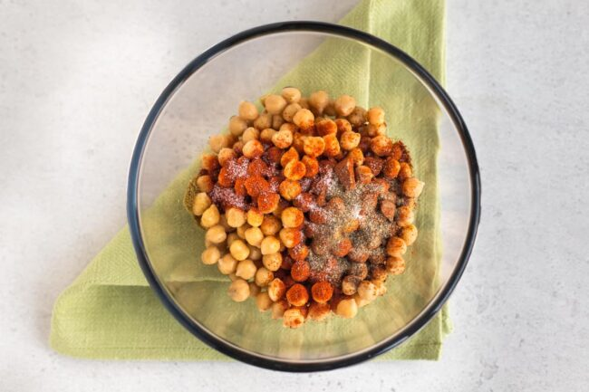 Chickpeas in a bowl with spices.