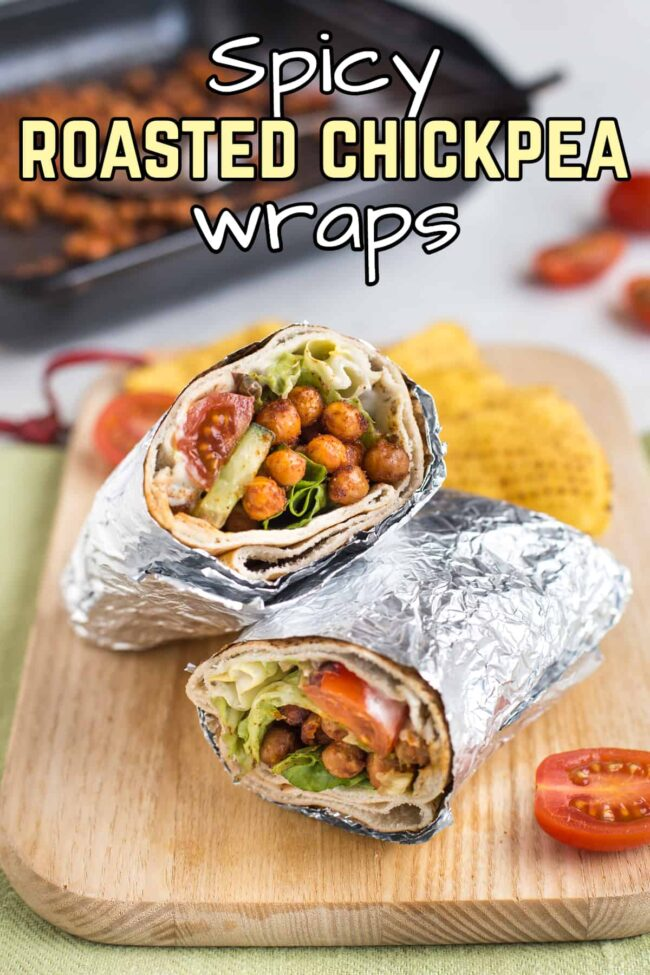 A spicy roasted chickpea wrap rolled up in foil and cut in half.