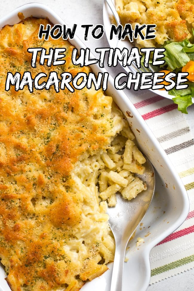 Large dish of macaroni cheese with a crispy topping, with a portion removed with a spoon
