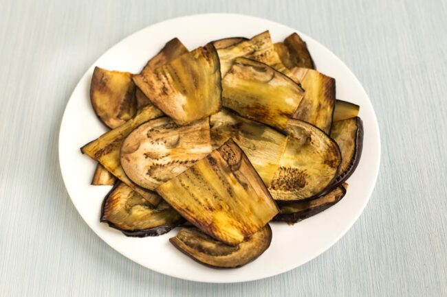 A plateful of sliced and grilled aubergine (eggplant).