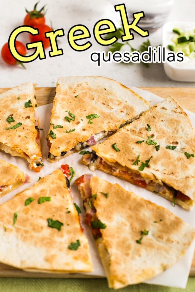 Greek quesadillas on a board, chopped into slices