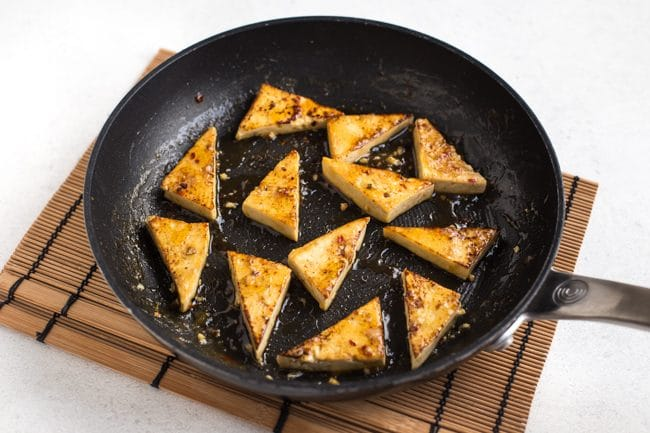 Sticky lemon tofu in a frying pan