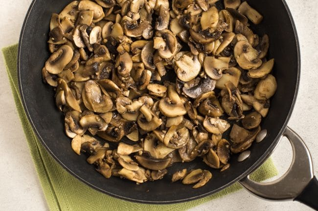 Garlic mushrooms in a frying pan