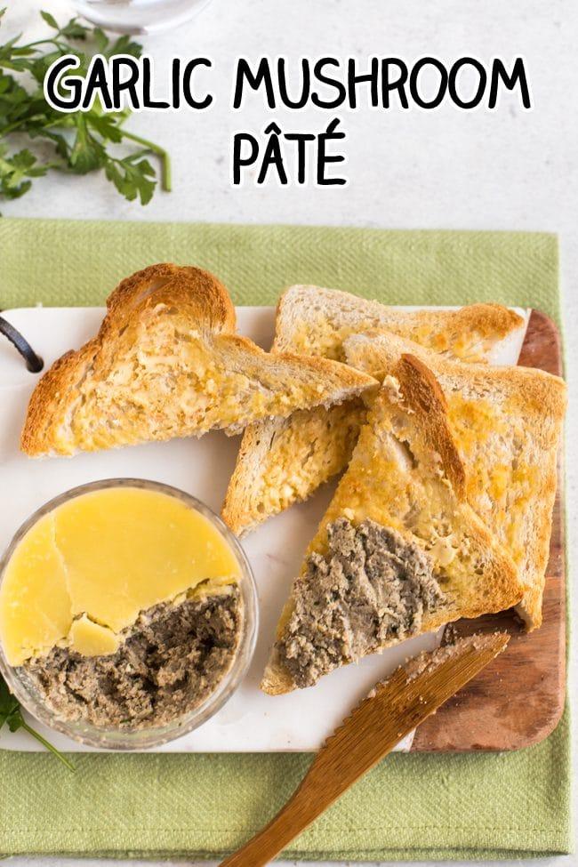 Mushroom pate spread on toast triangles, on a marble board