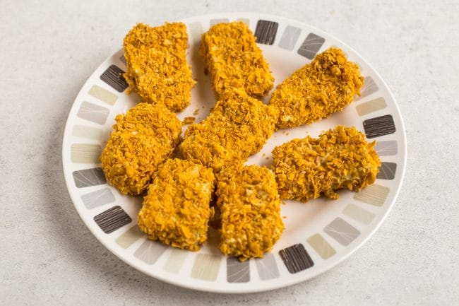 Uncooked breaded tofu chicken nuggets on a plate