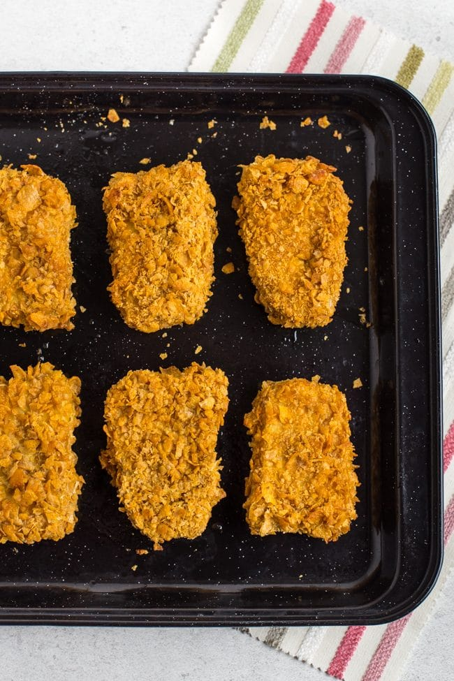 Breaded tofu chicken nuggets on a baking tray ready for cooking