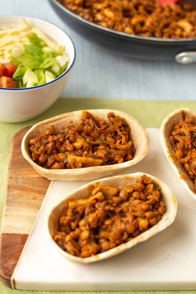 Stand-and-stuff taco shells stuffed with a smoky lentil mixture.