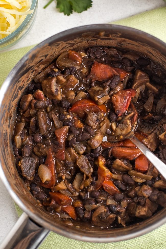 Mushroom and black bean chilli in a saucepan shot from above