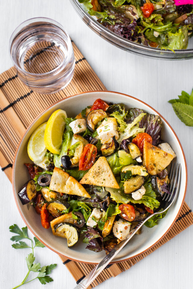 Roasted vegetable fattoush in a bowl.