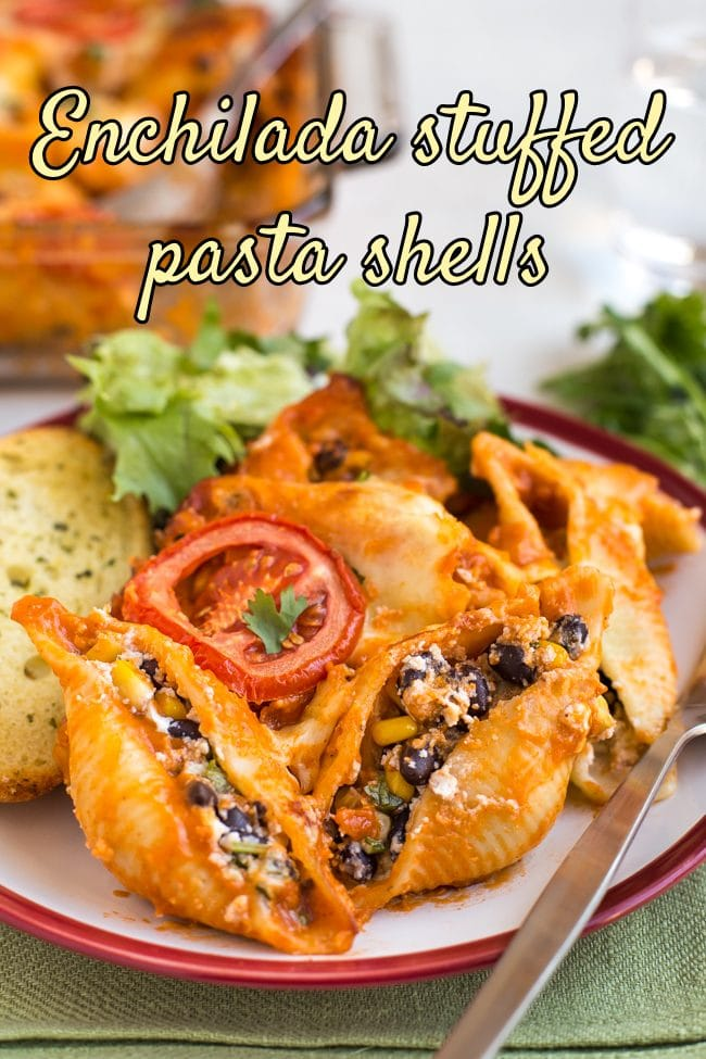 Portion of enchilada stuffed pasta shells on a plate with a fork