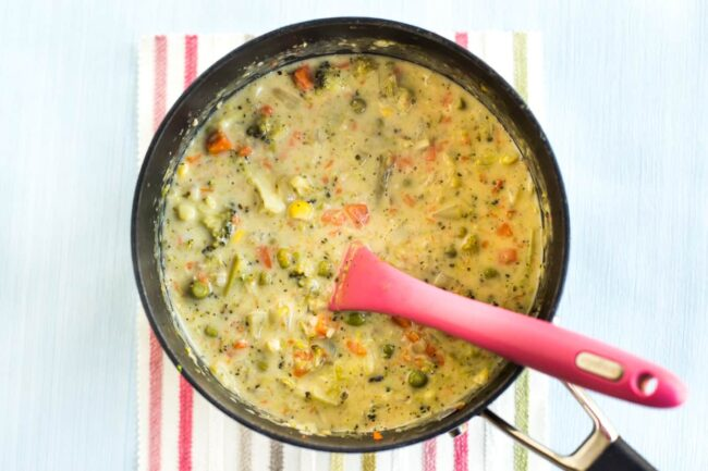 Creamy veggie pot pie soup in a pan