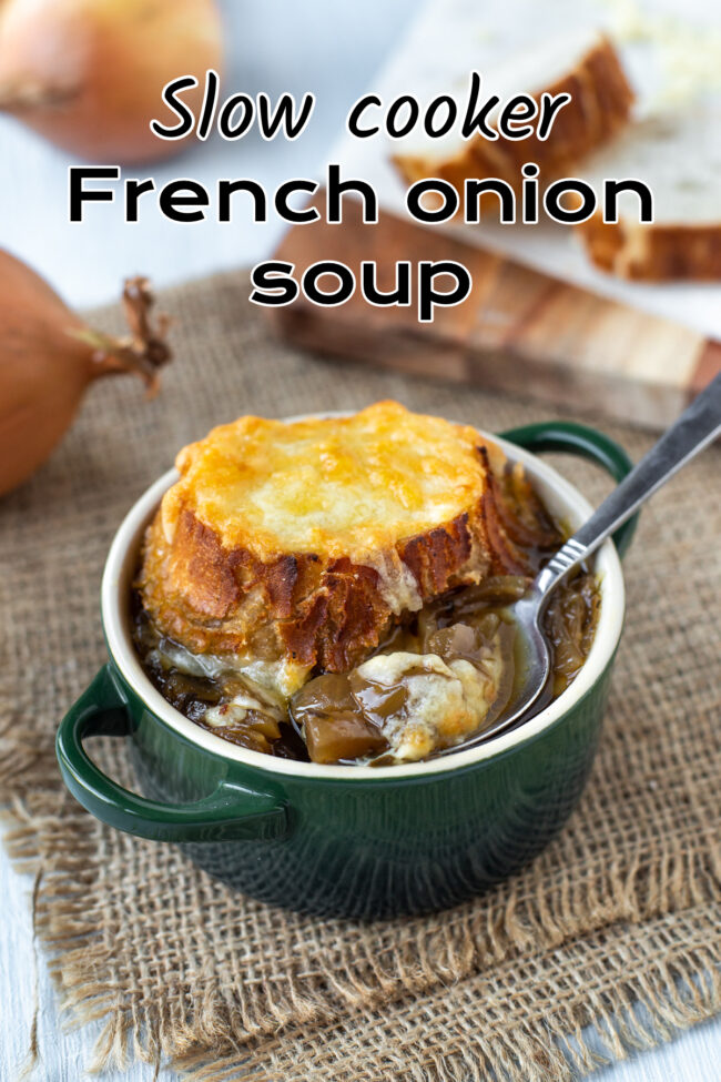 A bowl of French onion soup topped with a crispy cheese crouton.