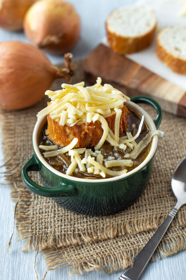 French onion soup topped with a slice of French bread and grated cheese.