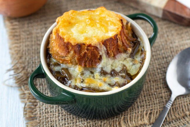 French onion soup made in the slow cooker with a golden brown cheesy crouton.
