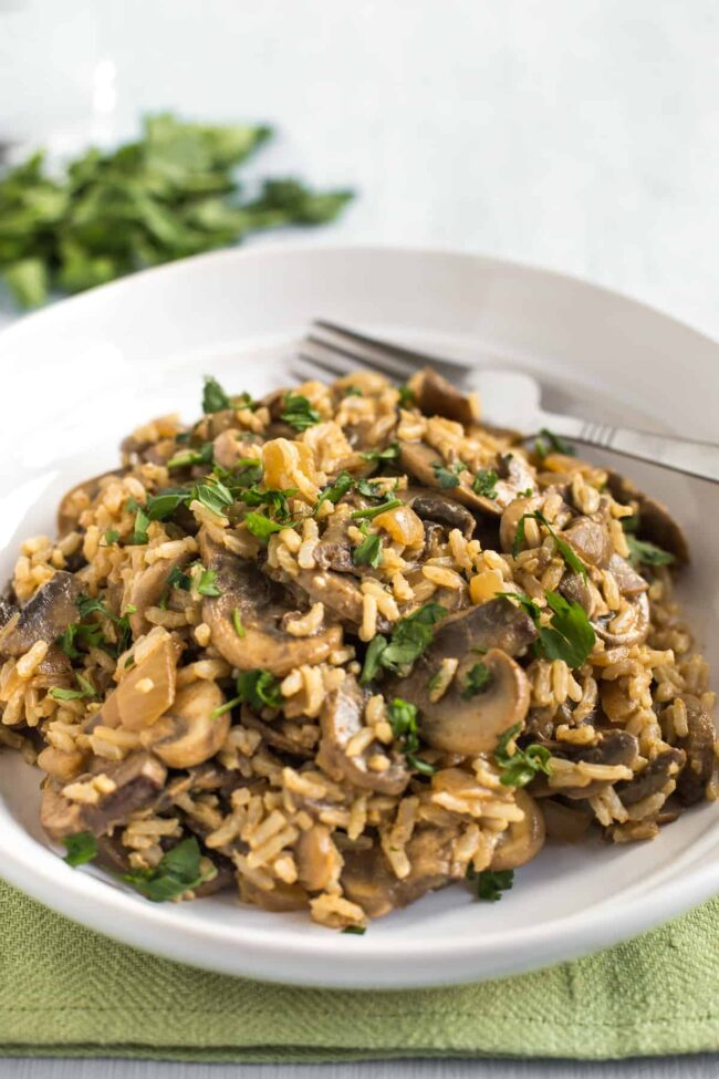 Portion of creamy mushroom stroganoff mixed with rice in a bowl