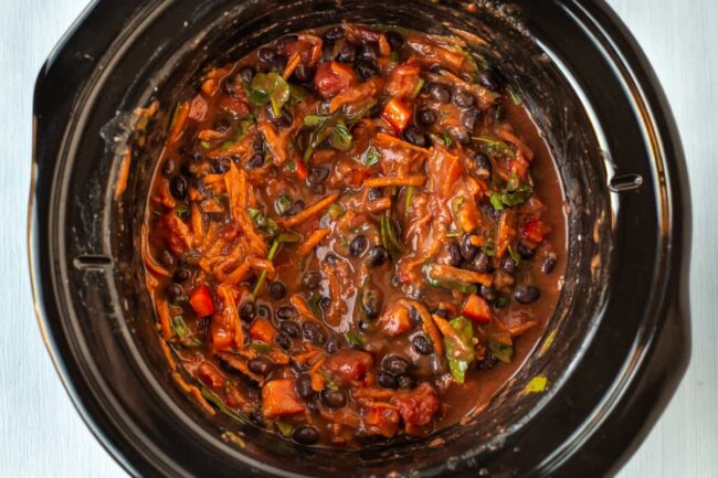 Uncooked black bean soup in a slow cooker.