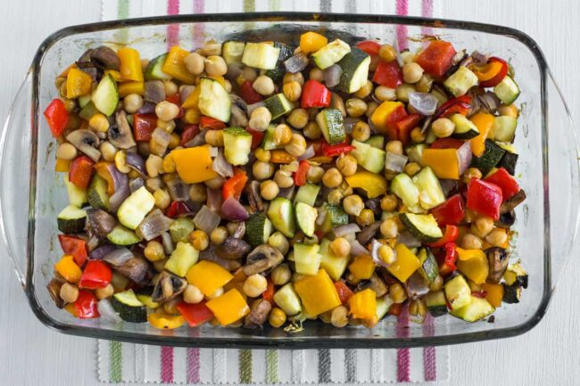 Roasted vegetables and chickpeas in a baking dish