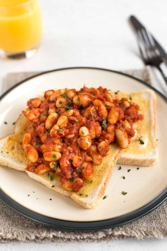 Two slices of toast with homemade baked beans.