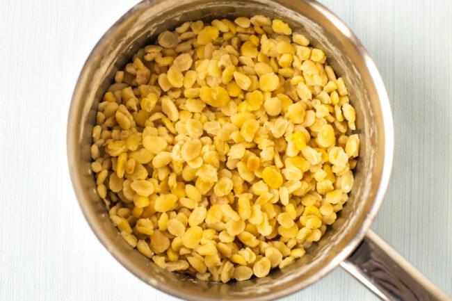 Boiled split fava beans in a pan.