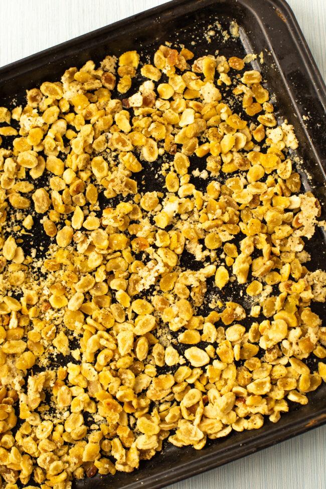 Crispy roasted fava beans on a baking tray.