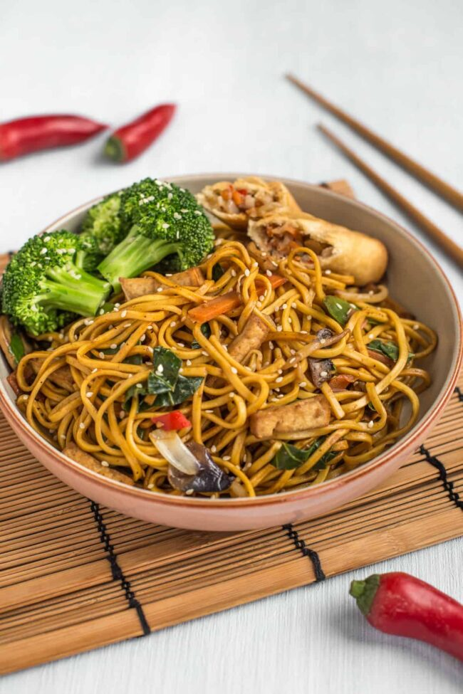 Chinese vegetable noodles with broccoli in a bowl.