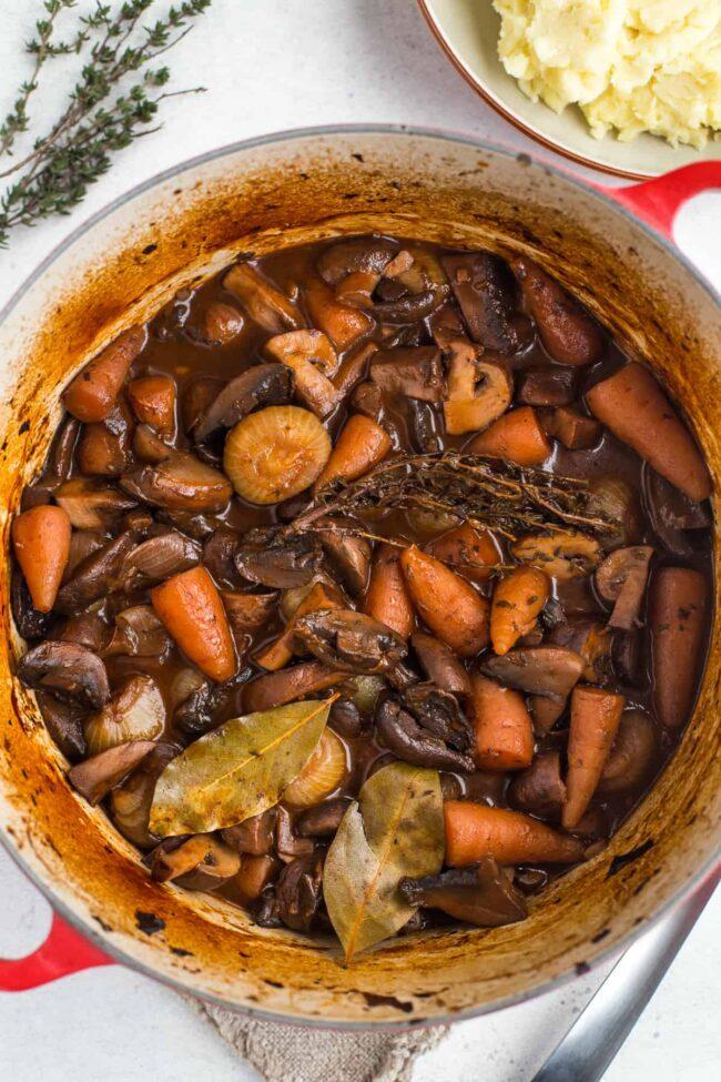 Large casserole dish filled with mushroom bourguignon.