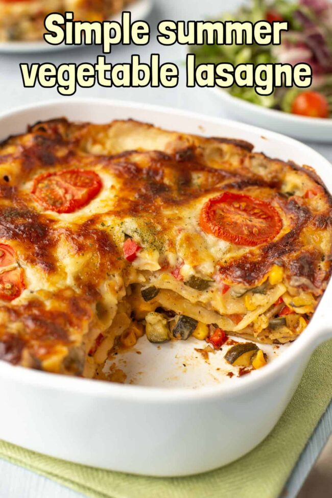 A creamy vegetable lasagne in a dish, with a slice removed.