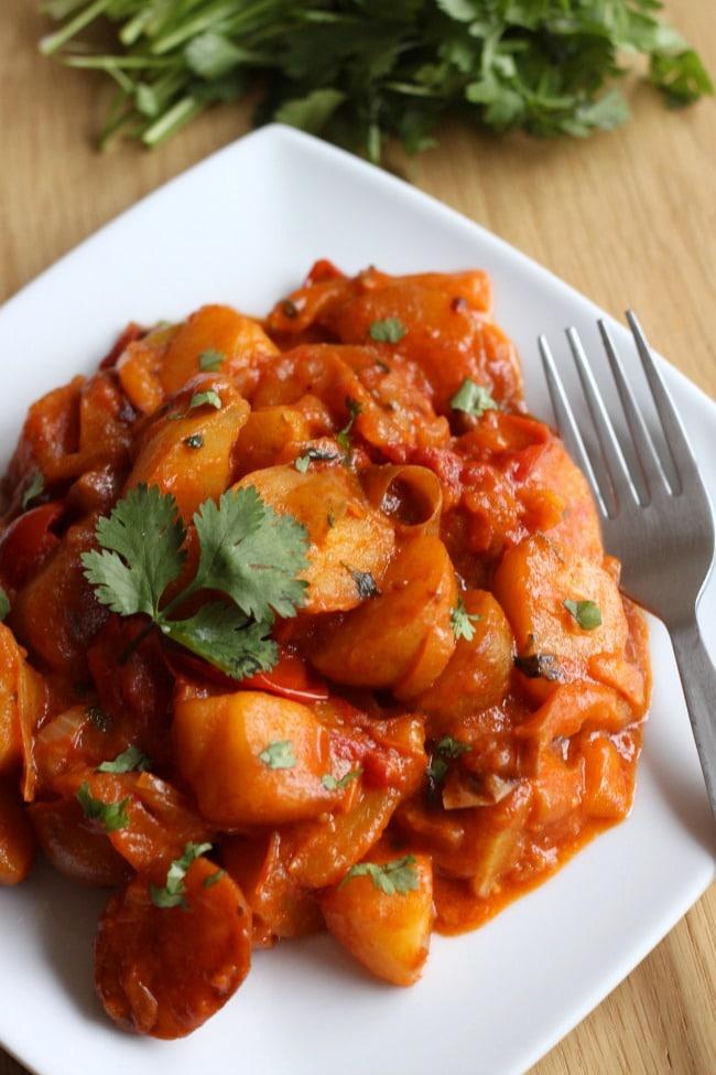 Cheesy Mexican potatoes - suuuuuper cheesy, spicy, tomatoey potatoes!