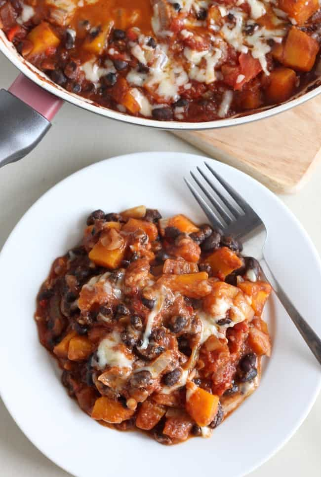 Butternut squash and black bean skillet - a hearty, autumnal one-pot meal with squash, beans, and loads of gooey cheese!