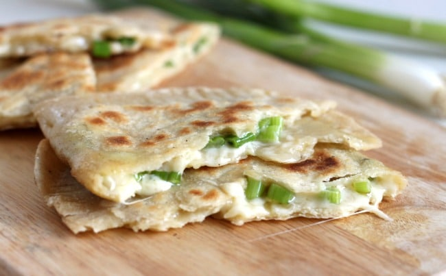 Cheese and onion stuffed flatbreads - oozing with cheese and spring onions, these stuffed flatbreads are really easy to make!