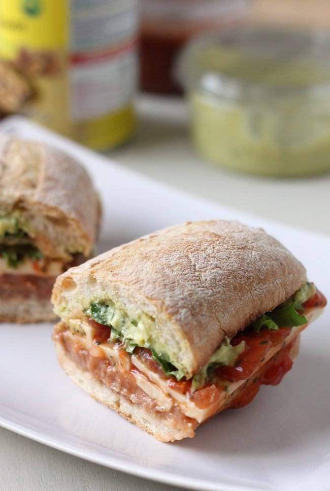 Mexican torta - the best sandwich EVER! Refried beans, guacamole, salsa, cheese and lettuce - a Mexican feast :)