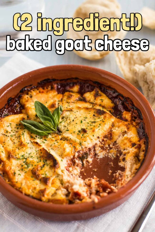 Baked goat's cheese in tomato sauce with a scoop removed