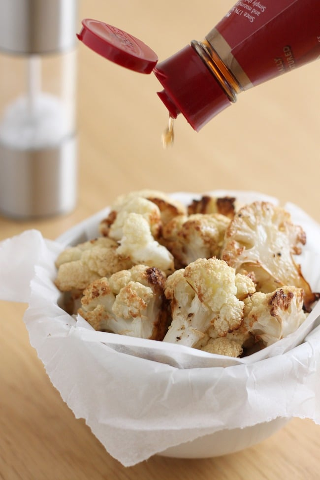 Salt and vinegar roasted cauliflower - a super healthy, low carb snack that's just as tasty as greasy salt and vinegar crisps!