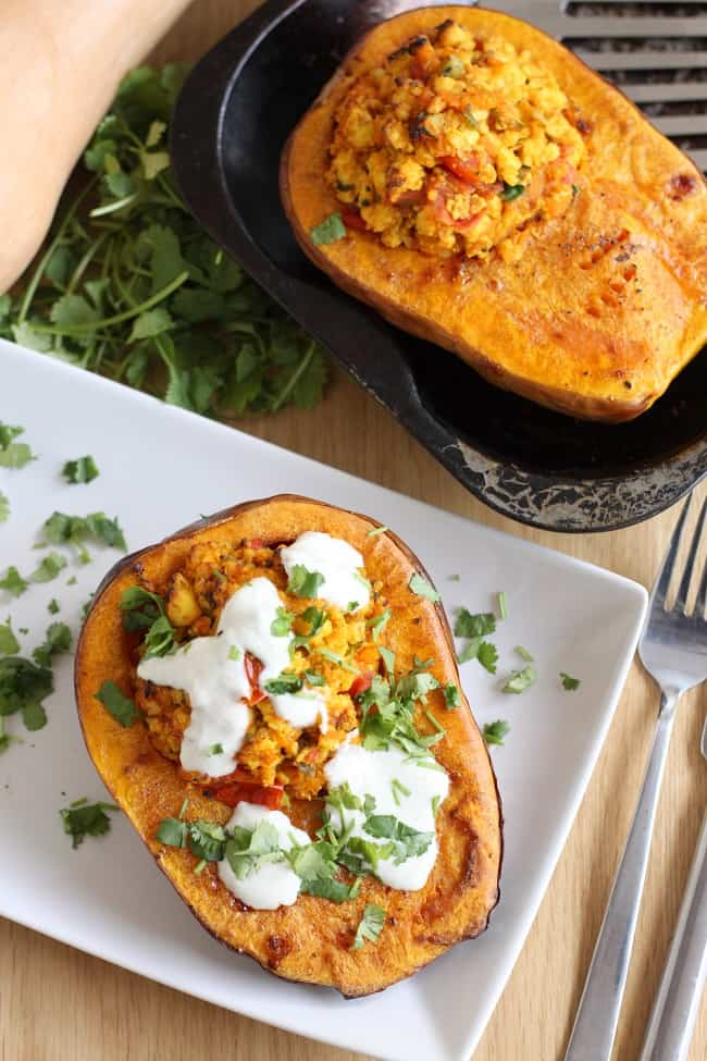 Paneer stuffed butternut squash with spiced yogurt - a great vegetarian option for an alternative Thanksgiving!
