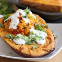 Paneer stuffed butternut squash with spiced yogurt