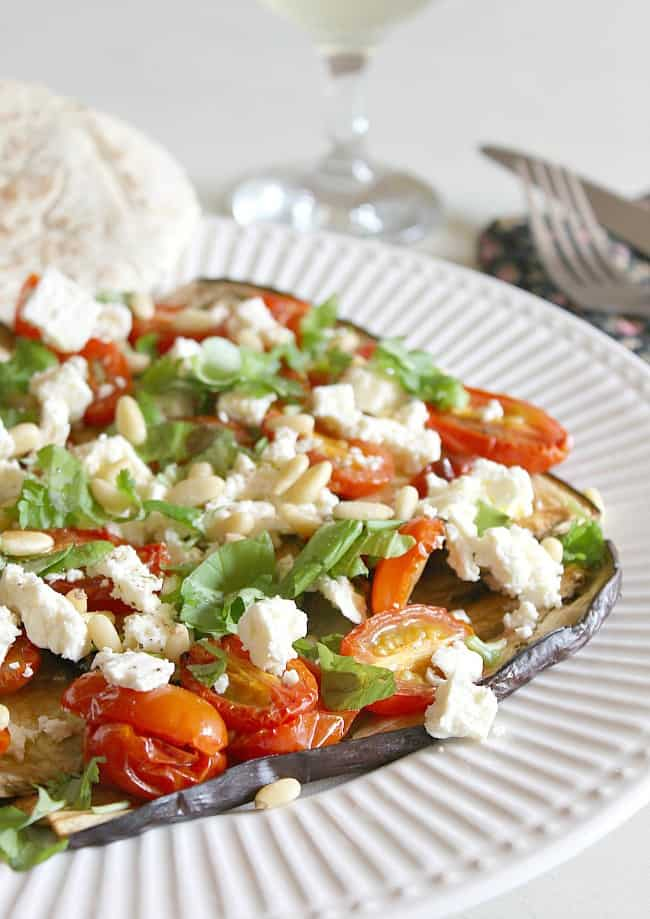 Roasted tomato and aubergine salad with feta and pine nuts