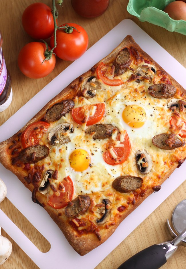 Breakfast pizza. Veggie sausages, mushrooms, pizza and eggs - perfectly reasonable for breakfast!!