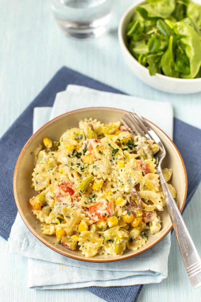 A portion of pasta primavera in a bowl.