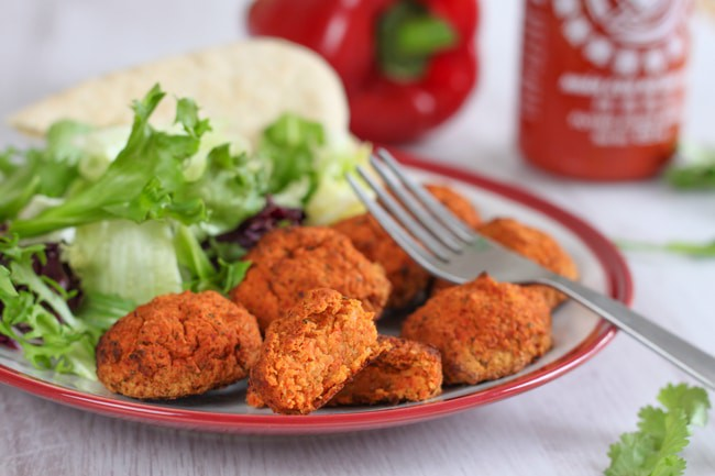 Roasted red pepper falafel with sriracha - sweet and spicy, and perfect in pitta bread with salad and a drizzle of sauce!