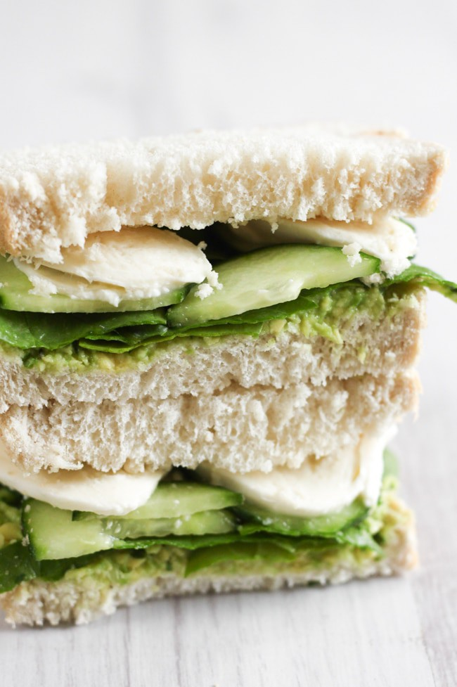 Green goddess sandwiches - creamy avocado spread, crunchy cucumber and baby spinach, and fresh mozzarella. Unbelievably tasty!