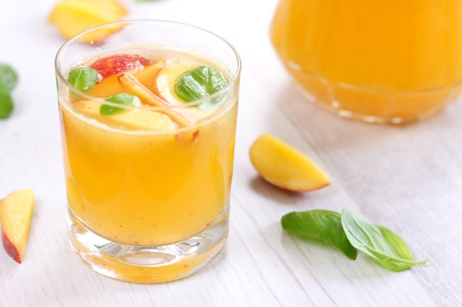 Peach and basil white sangria - take a sip, close your eyes and say 'ahhh!'