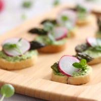Watercress and goat's cheese crostini with asparagus