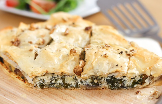 Kale and mushroom savoury baklava - crispy filo pastry stuffed with a creamy savoury filling, drizzled with honey and sprinkled with chopped nuts.