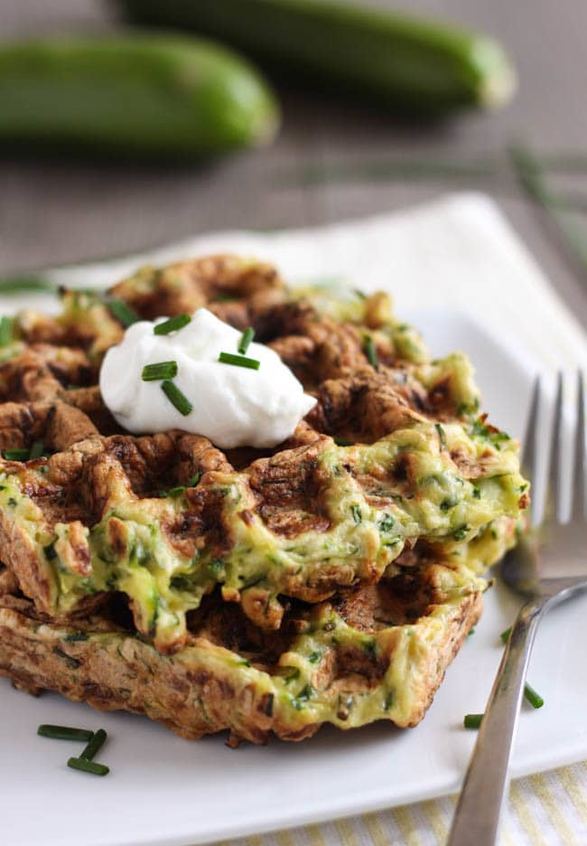 Courgette fritter waffles - a cross between a crispy zucchini fritter and a cakey waffle. So fun and delicious too!