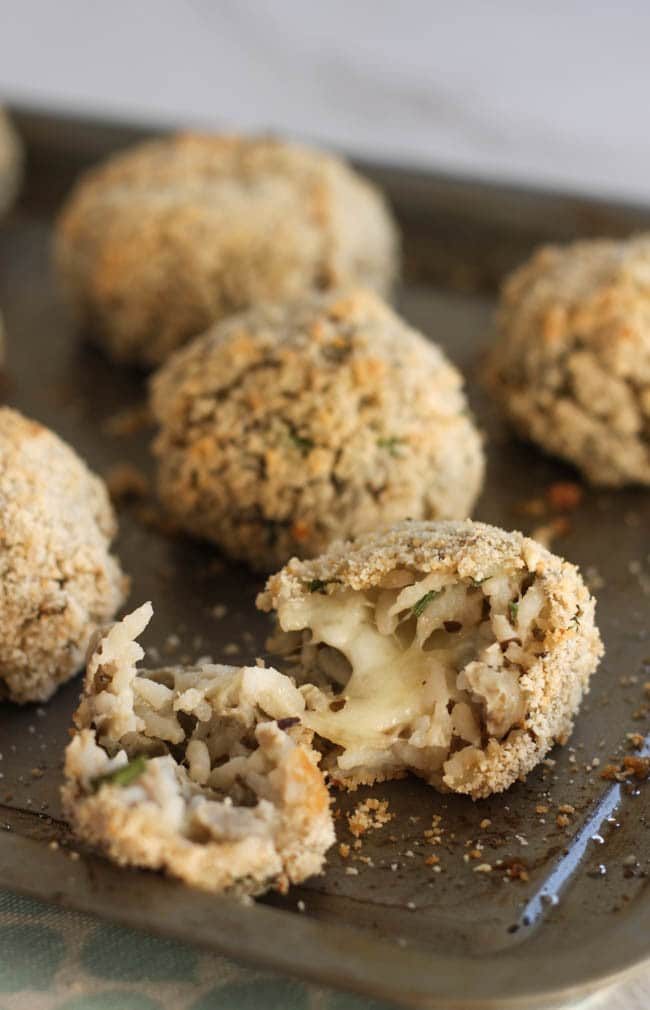 Mozzarella-stuffed aubergine and rice balls. I've always wanted to make arancini, but never have any leftover risotto - these are a much easier way to make them! The gooey mozzarella inside is enough to make you swoon :)