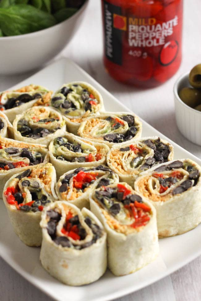 Cheesy Tex Mex tortilla roll-ups - THESE ARE MY NEW FAVOURITE LUNCH EVER! They're creamy, cheesy, spicy, and just SO tasty. Great for a packed lunch, or to serve on a platter at a party! Definitely one I will revisit again and again :)