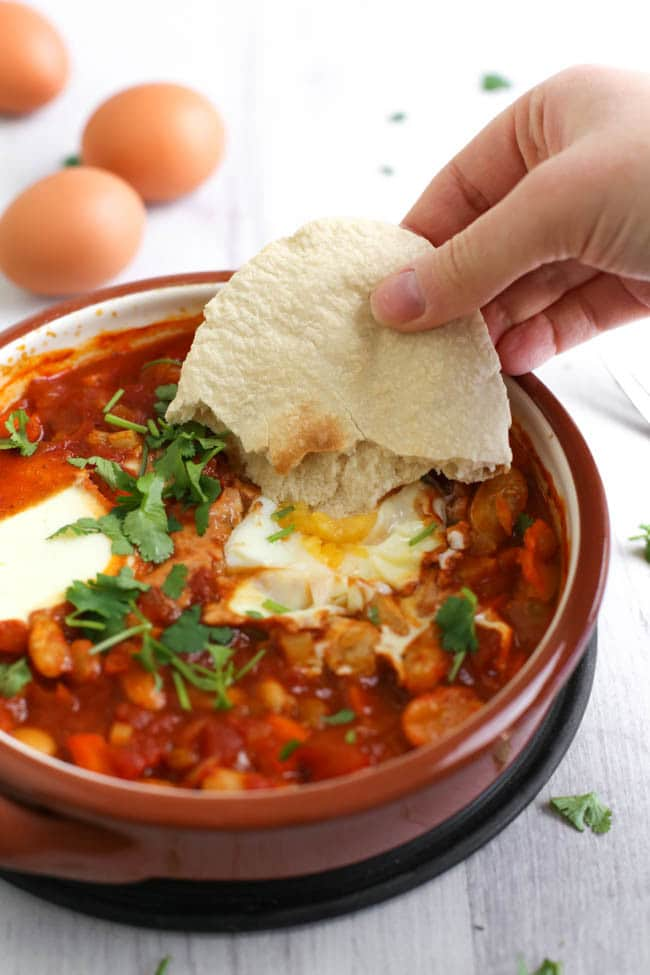 Cannellini bean shakshuka (eggs baked in a rich tomato sauce) - a hearty, high protein breakfast or lunch. It's vegetarian, really easy to make an totally delicious!