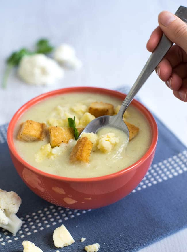Creamy cauliflower cheese soup - this is totally swoon-worthy!! It's thick, it's creamy, and it's actually pretty healthy! A really easy vegetarian soup.