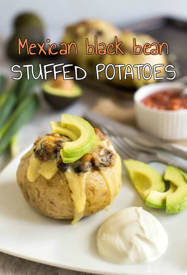 Mexican black bean stuffed potatoes - an easy way to make potatoes the star of the show! Stuffed with black beans and salsa, and topped with plenty of cheese. A fab vegetarian dinner!